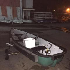 Sampan with outboard