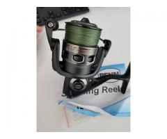 Penn Conflict 4000 Spinning Reel loaded with PE 2 braid