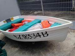Small boat with 3HP Yamaha Engine