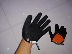 latex glove with magnetic quick release feature