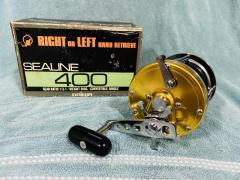 Brand new Gold Daiwa Sealine 400 ( convertible right or left retrieve)