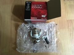 Selling New and Used size 1000/3000 Shimano reel